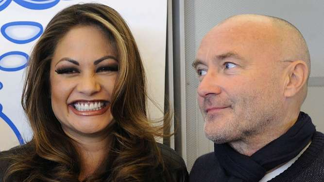 "(FILES) In a file picture taken on October 21, 2010 British pop star Phil Collins (R) poses with his former wife Orianne (L) during a press conference about their ""Little Dreams Foundation"" on October 21, 2010 in Nyon.British rock star Phil Collins has gotten back together with his ex-wife Orianne and the couple aims to remarry, she said in an interview published on February 21, 2016 . / AFP / FABRICE COFFRINI"