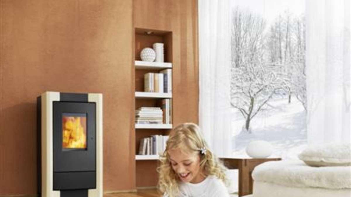 wohlf hlen und kosten sparen mit pellet fen von rika wohnen. Black Bedroom Furniture Sets. Home Design Ideas