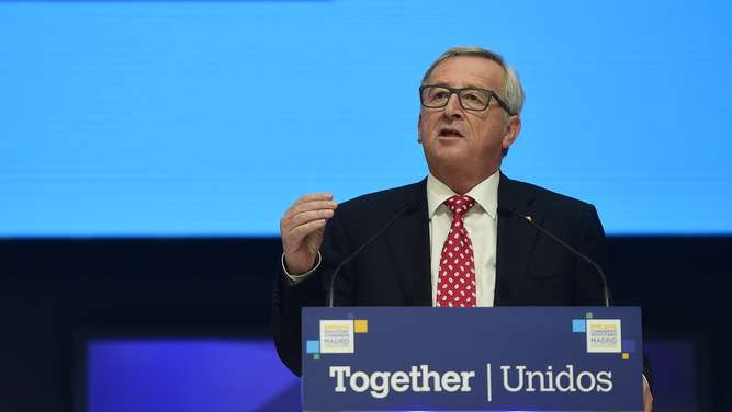 Luxembourgish President of the European Commission Jean-Claude Juncker delivers a speech during the European People&#39s Party Statuary Congress in Madrid on October 22, 2015. The EPP congress, which groups conservative parties from across the EU, is expected to adopt a four-page resolution tonight that calls for improvements in the reception of migrants but also demands the strengthening of the EU&#39s external borders. AFP PHOTO/ PIERRE-PHILIPPE MARCOU
