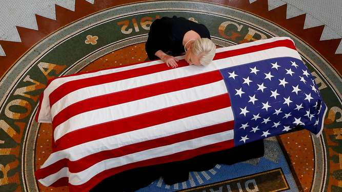 John McCain&#39s body lies in state at the Arizona State Capitol where the public can pay their respects.