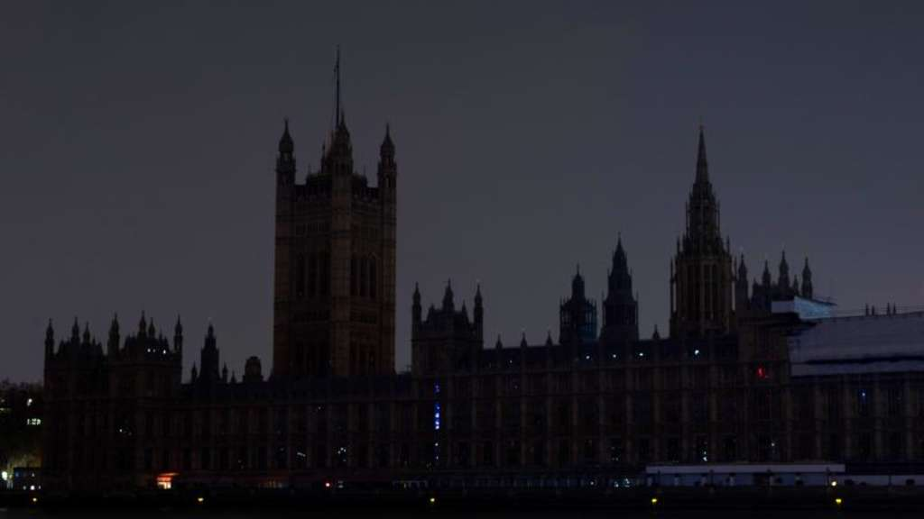 Der abgedunkelte Londoner Palace of Westminster während der Earth Hour 2019. Foto: David Parry/PA Wire/dpa